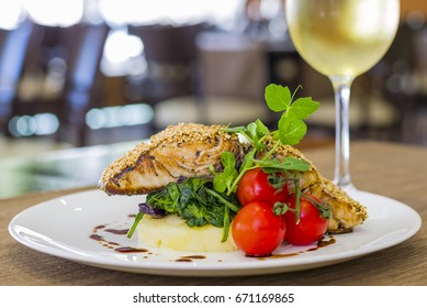 Seared salmon fillet with wine on restaurant background