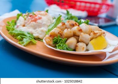 Seared scallops and potato salad in PEI