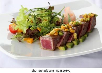 Seared tuna with mango salsa, avocado and salad