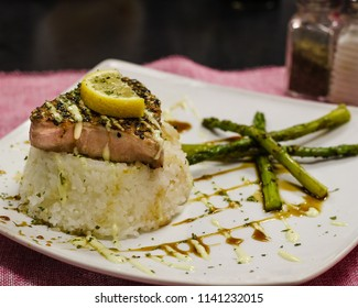 Seared Tuna on a bed of rice with asparagus