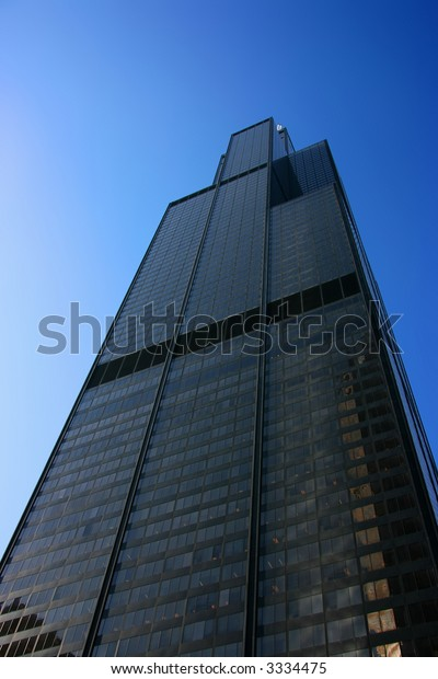 Sears tower seen from below over a blue sky