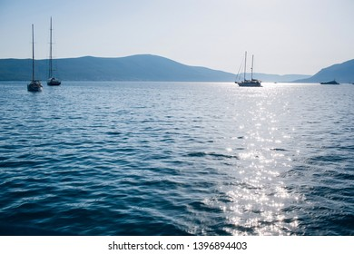 Seascape of the Adriatic Sea. The sea with mountains and mountains in the background. Boat sailing on the sea. Italy, Montenegro, Adriatic tourism