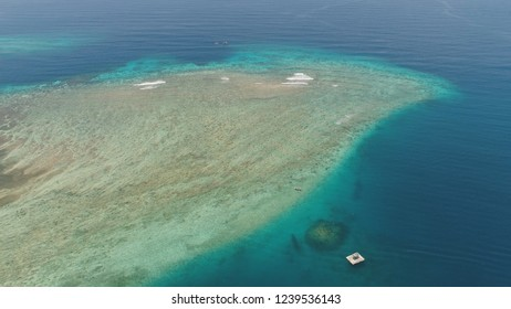 seascape aerial view coral reef, atoll with turquoise water in sea.Tropical atoll, coral reef in ocean waters. Travel concept.