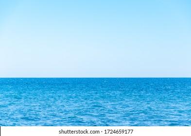 Seascape background vivid blue sea and clear sky