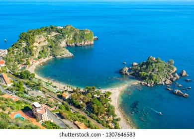 Seascape with beach and island Isola Bella (beautiful island) in Taormina. Sicily, Italy