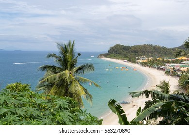 Seascape of beach with transparent sea, blue sky, palms and boats.Taken Sabang, popular tourist and diving spot.