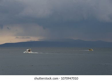 Seascape with beautiful clouds on croatian Adria, two boats on the sea