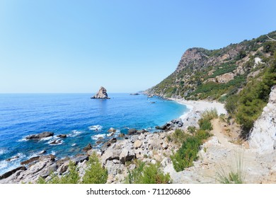 Seascape with beautiful picturesque bay, turquoise sea and some rocks in the water