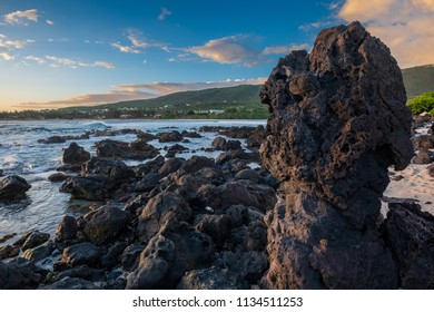 Seascape with big volcanic rock at Pointe des Trois Bassins in la Reunion island, a french overseas department in the Indian Ocean