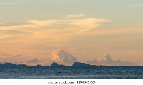 Seascape bright blue sea skay white clouds background at dusk