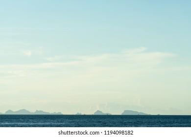 Seascape bright blue sea skay white clouds background