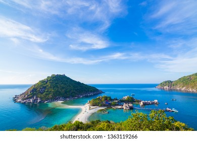 Seascape coastline morning sunny day blue sky with idyllic island, Koh nangyuan Suratthani