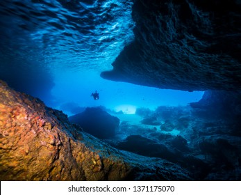 Seascape of coral reef in the Caribbean Sea around Curacao at dive site Blue Room, a special cave