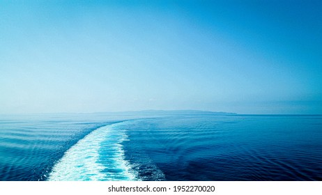 Seascape of a cruiseboat passage in the sea. Beautiful horizon of the ocean. Vacation perfect spot.