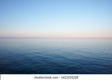 Seascape in delicate pastel colors with the horizon of the sea and clear sky early in the morning. Mediterranean Sea - Shutterstock ID 1421924258