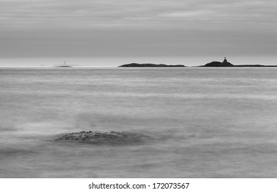 Seascape with distant light house