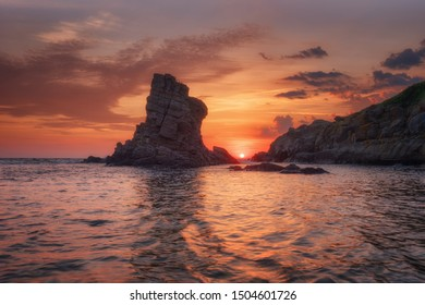 Seascape during sunrise. Beautiful natural seascape. Sea sunrise at the Black Sea coast. Magnificent sunrise with clouds and fire sun at the end of May.The Ships, Sinemorets, Bulgaria