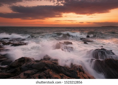 Seascape during sunrise. Beautiful natural seascape. Sea sunrise at the Black Sea coast. Magnificent sunrise with clouds and fire sun at the beginning of September. Chernomorec, Bulgaria