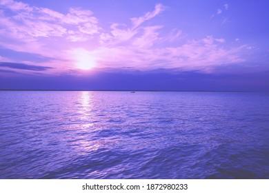 Seascape in early morning, sunrise over the sea. Seashore during sunrise