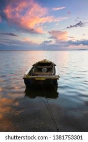 Seascape of a fisherman's boat at sunrise/sunset
