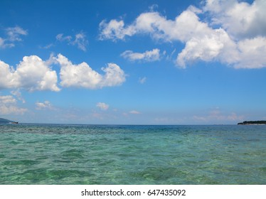 Seascape of Gili Islands at sunny day in Lombok, Indonesia. Lombok is known for beaches and surfing spots, particularly at Kuta and Banko Banko.