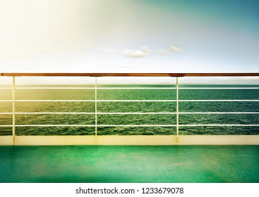 Seascape horizon at ship deck. Sun reflection and warm toned vintage look