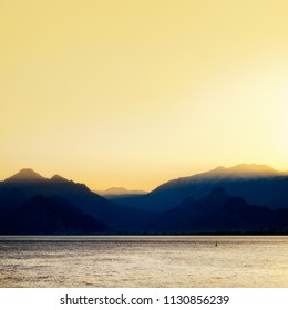 seascape image of high mountains over clear sunset sky in Antalya, Turkey