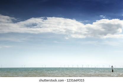 seascape image of wind turbines out to see shot in england