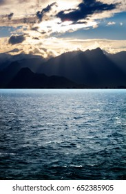 seascape image of windy weather and waves on sea over cloudy sky during sunset in antalya