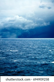 seascape image of windy weather and waves on sea over cloudy sky