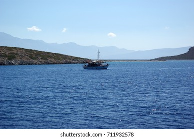Seascape with island. Boat surroundings of the island of Crete, Greece.