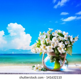 seascape and jasmine flowers