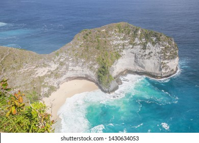 Seascape of Kelingking Beach on Nusa Penida Island, Bali, Indonesia with wave action and turquoise water