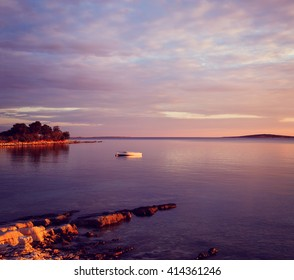 Seascape with Lonely Boat in Sea at Sunset
