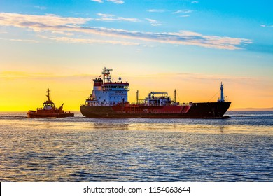 Seascape - LPG Tanker ship at sunrise.