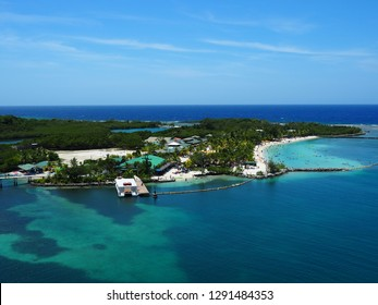 Seascape of Mahogany Bay, Isla Roatan, with beautiful blue water and natural green trees on the island