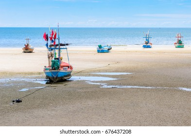 Seascape. Many small fishing boat moored anchor on beach