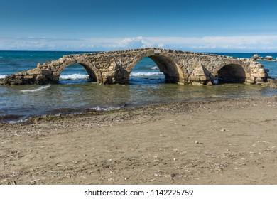 Seascape with medieval bridge in the water at Argassi beach, Zakynthos island, Greece