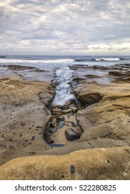 seascape, ocean, clouds, rocky beach. Hospitals Reef, La Jolla, California, USA.