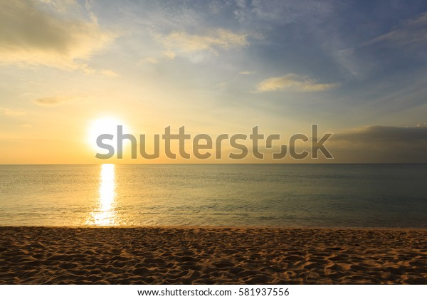 Seascape on Sunset of Mai Khao Phuket, Thailand Beach Under Beautiful Cloud Sky. Set as Blank Frame for Text.