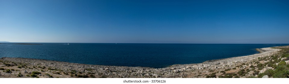 Seascape Panorama with typical garigue landscape found in Malta in the foreground