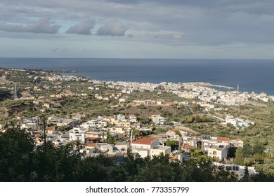 Seascape. Panoramic, picturesque view of the city resort Hersonissos (Greece, island Crete) and the sea from the height on a sunny evening.