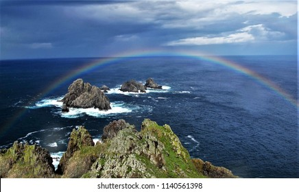 seascape with rainbows on the north coast of Galicia, the cape ortegal and the Aguillons, Carino,A Coruna,Galicia, Spain, oldest rocks in the world,amphibolites, Next to the highest cliffs of Europe c