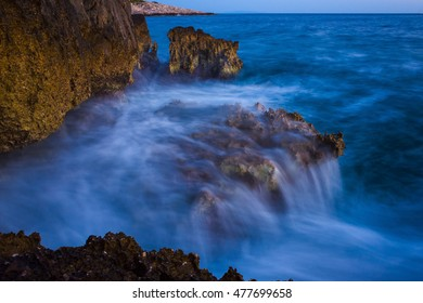 seascape Razanj Croatia Europe. Beautiful nature and landscape photo of Adriatic Sea in Dalmatia. Rocks, stones, reef and flowing water waves. Nice colorful long exposure image. Calm, peaceful picture