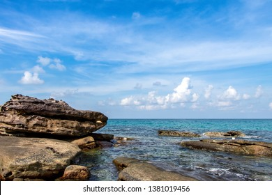 Seascape and rocks by the sea.View piont at Koh Kood Island in Trat province of Thailand.Background is white clouds and blue sky.