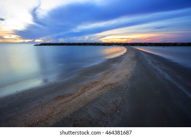 Seascape with rocks and sand