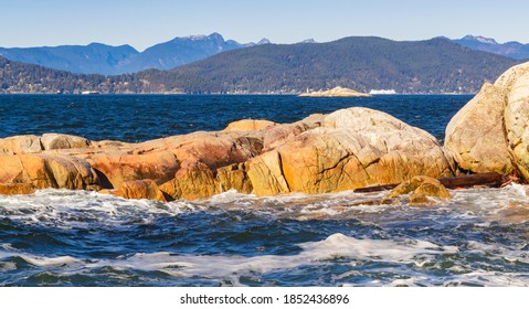 Seascape of the rocky shoreline and ocean waves in the West Vancouver Park BC/Canada. Selective focus, travel photo, npbody.