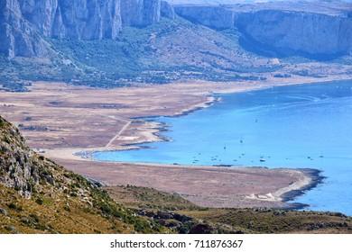 """Seascape of """"Santa Margherita"""" beach and """"Monte Cofano"""" reserve from the peak of """"Monte Monaco"""" mountain , San Vito Lo Capo, Trapani, Sicily, Italy"""