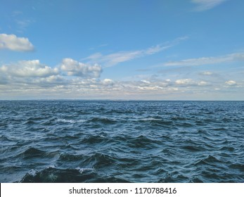 Seascape Sea with calm water and white clouds