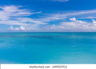 Seascape with sea horizon and deep blue sky in calm and sunny weather. Panoramic beautiful seascape with cloud on a sunny day. Endless blue sea view